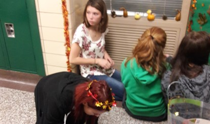 French Students preparing for Fall Door Decorating Contest